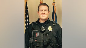 Officer shot in the neck recovering in hospital;  fundraising effort underway