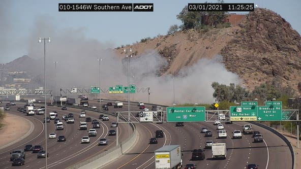 Brush fire burns near I-10 and Broadway