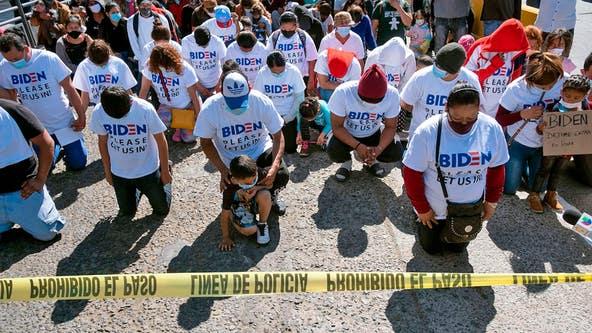 Migrants wear Biden T-shirts at US-Mexico border, demand clearer policies