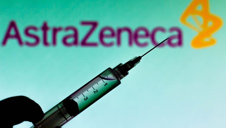 7c52904e-In this photo illustration a medical syringe is seen with
