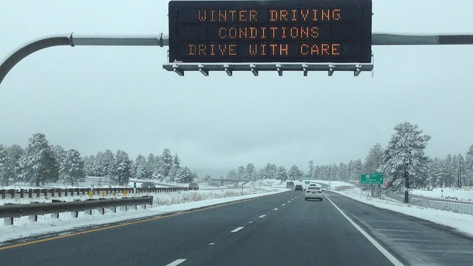 Overhead sign snow message
