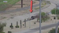 Car flips over into canal near Loop 303