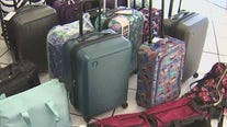 Suitcases, clothing collected for Arizona foster children