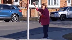 Elderly woman spreads love during pandemic by waving every day to strangers on street corner