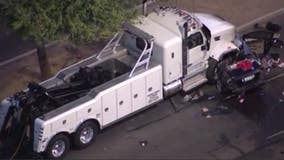 2 dead in car fire after tow truck collision in Phoenix, fire department says