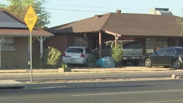 Woman who was shot several times and a man crash into a Phoenix home