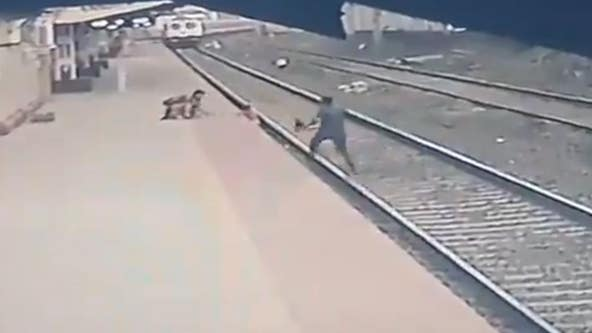 Railway employee in India rescues child who fell on tracks from oncoming train