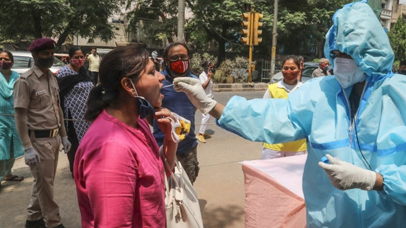 India's biggest cities shut down as new daily COVID-19 cases hit more than 200K