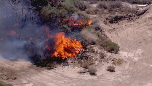 Crews battling brush fire in Goodyear, causing road closures