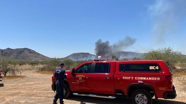Firefighters battle brush fire in North Phoenix