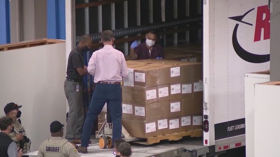 Boxes filled with ballots are delivered to the Arizona State Fairgrounds for the 2020 election audit