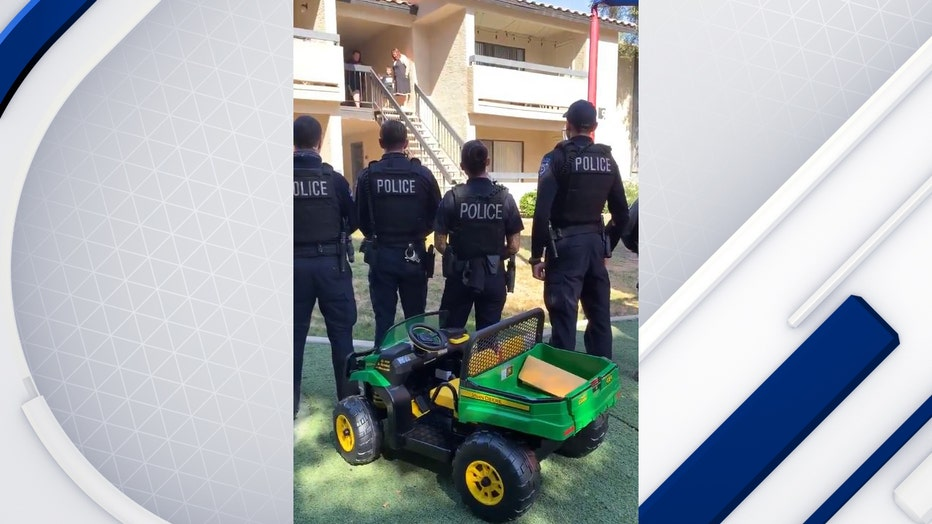 Tempe Police stand in front of gator tractor