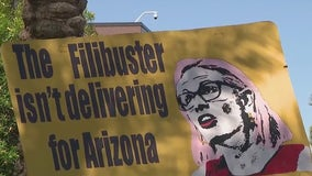 Protesters gather outside of Sen. Sinema's Phoenix office after missing Capitol riot commission vote