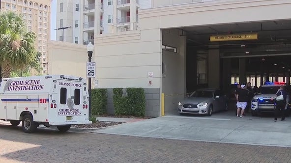 Police: Child caught in roll-up parking garage gate has died