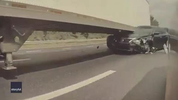 Tesla cameras capture moment trailing car crashes into 18-wheeler
