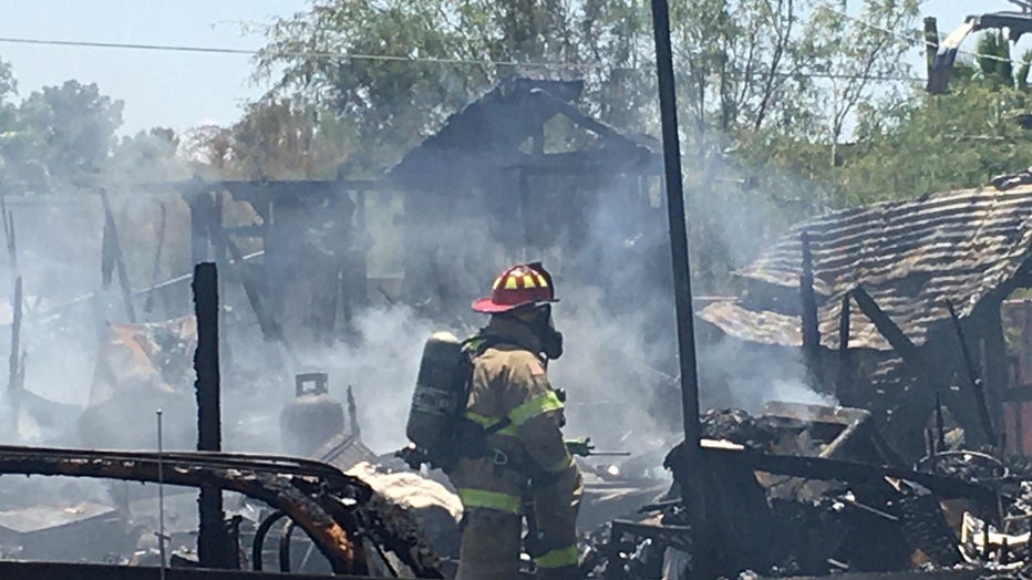 Arizona firefighter standing in front of rubble