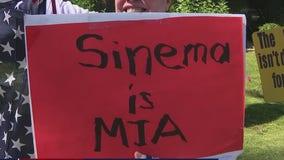 Activists rally outside of Sen. Sinema's Phoenix office