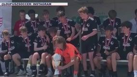 Soccer trophy breaks during team celebration