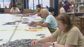 Sun City West residents assemble 42,000-piece puzzle