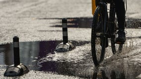 Girl falls off bike after lightning strike, is hit by car
