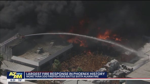 Recycling yard fire triggers largest firefighter response in Phoenix history