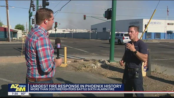 Phoenix fire crews still working to extinguish recycling yard fire