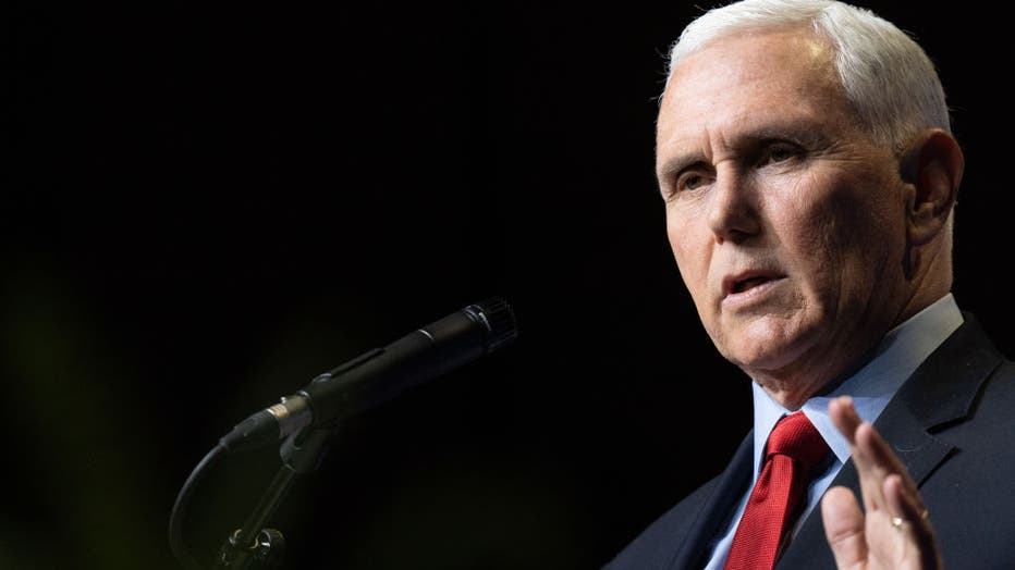 7657f47e-Mike Pence Delivers His First Address Since The End Of His Vice Presidency