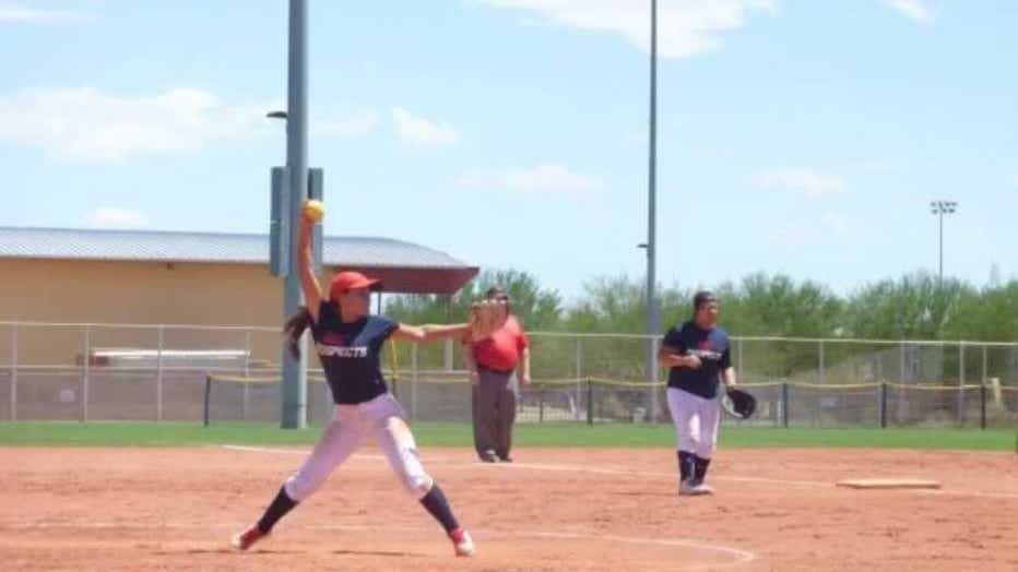 Mercedes Cabrales playing softball.