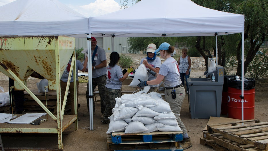 Volunteer organization, Team Rubicon, helps prep homes for possible flooding after wildfires.