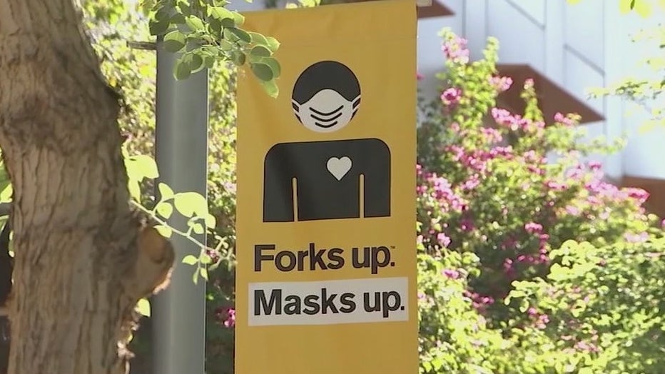 A sign on an ASU campus encouraging people to wear face masks.