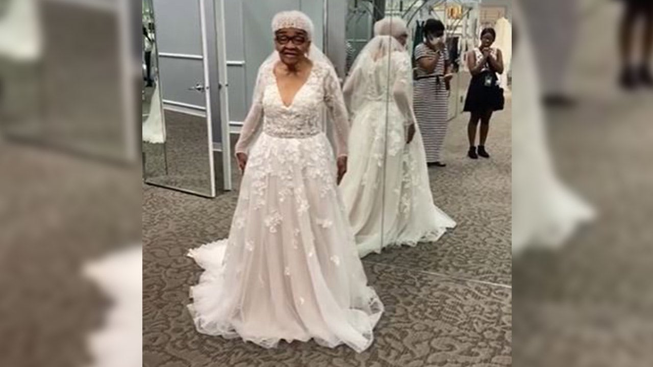 20 year old grandmother tries on wedding dress for 20st time