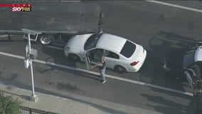 Police chase suspect in custody after flatbed truck cornered them mid-pursuit