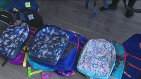Volunteers fill backpacks to hand out to over 4K kids preparing for school