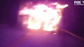 Bodycam video shows cop pulling people from burning house in New York