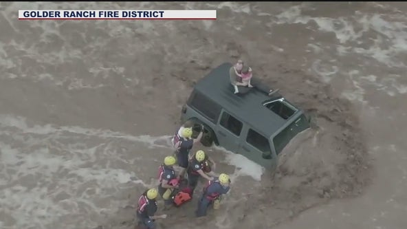 Fire crews rescue Tucson family during monsoon storm