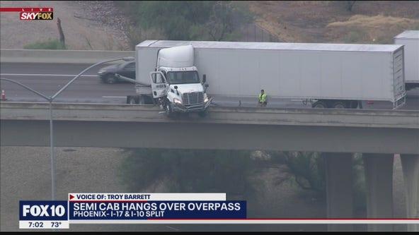 Jackknifed semi hangs over edge of Phoenix freeway