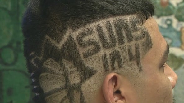 Phoenix Suns fan gets hair buzzed to show his support for the team