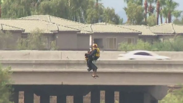 Avondale rescue crews work to help man out of tree on Agua Fria River