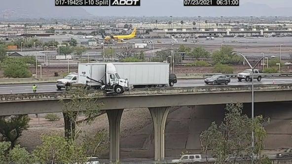 Jackknifed semi dangles over edge of I-17 in Phoenix