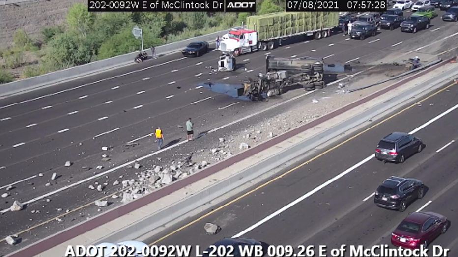 An overturned dump truck is causing major delays on Loop 202.