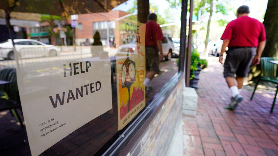Long Island restaurant window with help wanted sign