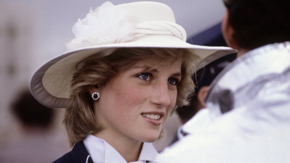 Diana Princess of Wales meets firemen during a visit to Manukau, near Auckland