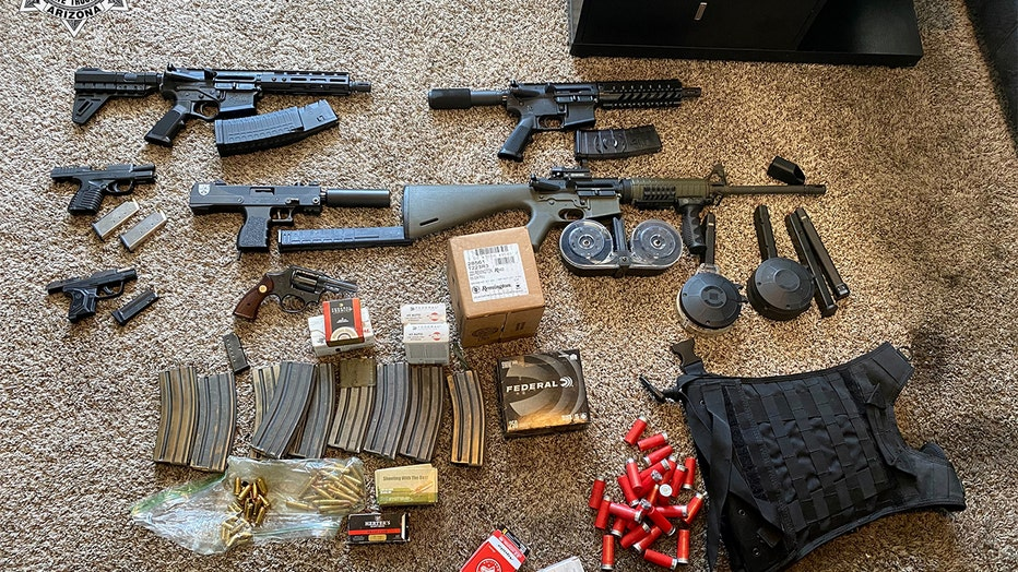 A photo showing all of the weapons found in Davis' home