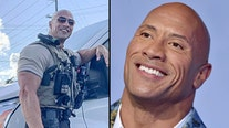 'It's very flattering': Alabama officer earns fame for striking resemblance to 'The Rock'