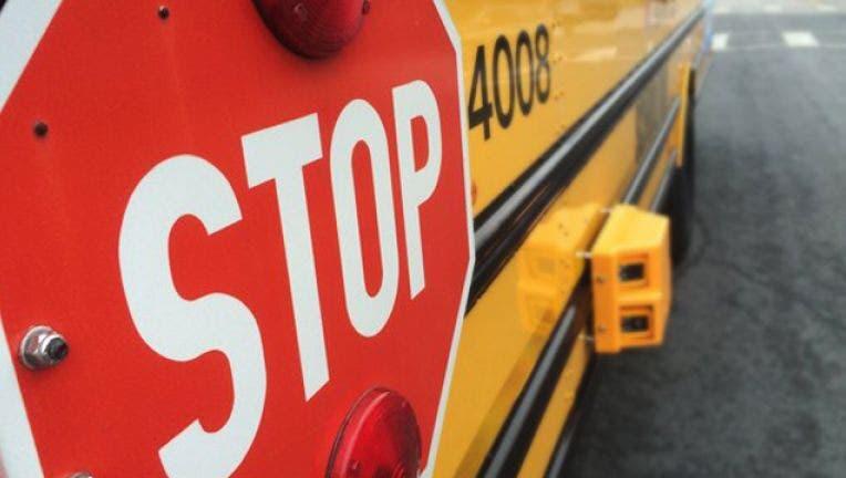 91c1b7e3-school bus stop sign