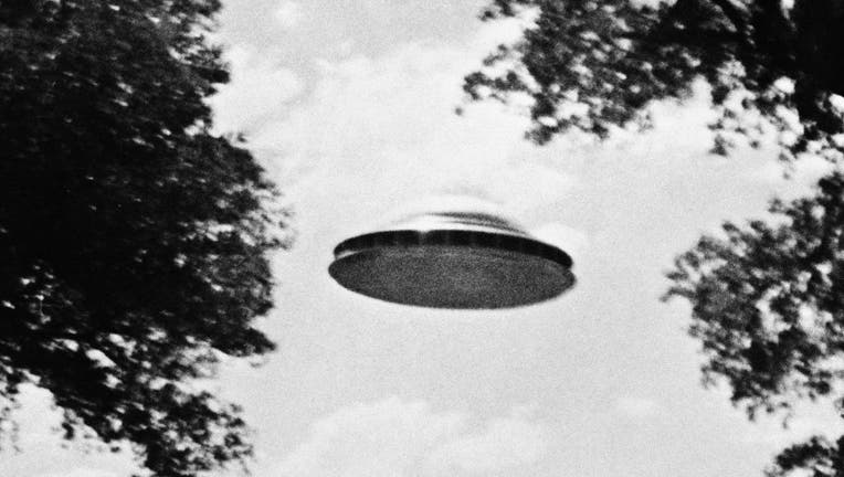 UFO Flying Low Over Trees