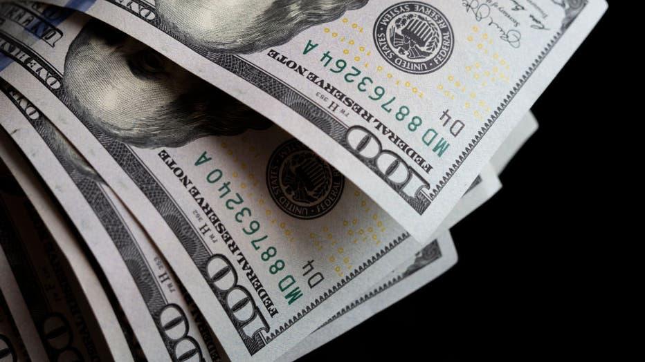 A photo illustration of US 100 dollar bills