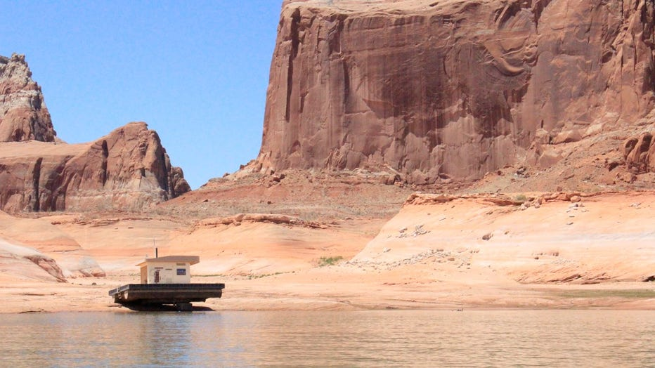 Changing lake levels has left this floating restroom stranded on rock in Lake Powell.