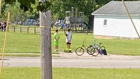 Boys hop off their bikes, pay respects during military veteran's funeral