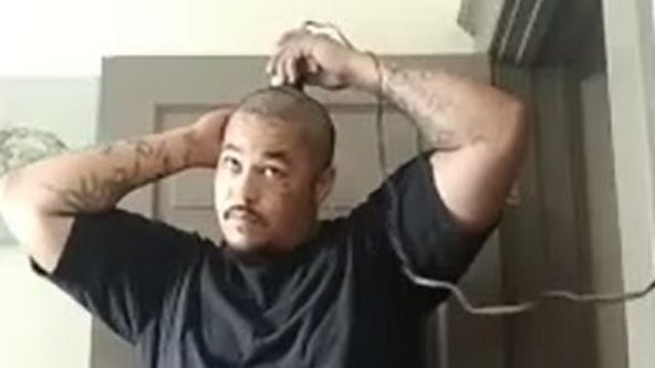 Ohio father shaves head in solidarity with son battling cancer